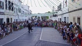 Riders rear up on his horse during a horse celebrations in the Spanish island of Minorca Stock Footage