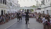 Slow motion view of riders rear up on his horse during a horse celebrations in the Spanish island of Minorca Stock Footage