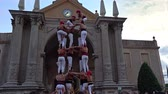 Castells Performance, a castell is a human tower built traditionally in festivals within Catalonia.