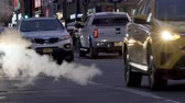 Manhattan street scene with steam coming from manhole cover