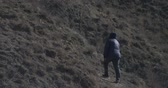 hiking trail : a woman walks the trail in autumn Stock Footage