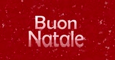 carmesim : Merry Christmas text in Italian Buon Natale turns to dust from bottom on red animated background Vídeos