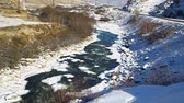 winter : Wildlife, clean, mountain river flowing in the valley