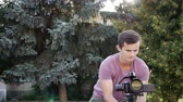 axis : filmmaker takes video with DSLR Camera on the Gimbal