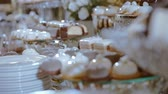 macaroons : Candy Bar In The Banquet Hall. Candy Buffet. Many Kind of Dessert. Cupcakes On The Table. Closeup And Rotate. Stock Footage