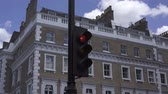 уличный фонарь : Traffic light in London with red light