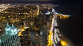 chicago : views of the waterfront from chicago heights. Night lights illuminate the city
