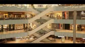 pipoca : a Large Shopping Center in Dallas. View of Escalators Which Lift and Descend the People on the Upper Floors. Many People Come to Shop. Stock Footage