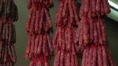 dry sausage : Dried shriveled-up red pork sausages or Lap cheong or Wax Sausages. Chinese cuisines.