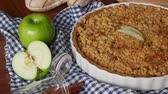 chroupat : Apple crisp or Apple crumble pie a dessert baked chopped apples topped with a crisp streusel crust. set on wooden table.