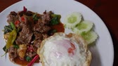çili : Dish of frying meat with basil leaves or Pad-kaprao with cooked rice and Fried egg. Thai food.