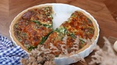 spinach : Quiche a savoury open tart or flan consisting of pastry crust with spinach mushrooms cheese. Stock Footage