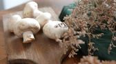 грибы : Button mushroom or white mushroom or champignon mushroom. set on table. Стоковые видеозаписи