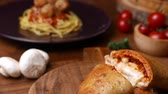turta : baked pizza puff set on dinner table. Stok Video
