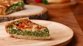 omelete : Quiche a savoury open tart or flan consisting of pastry crust with spinach mushrooms cheese. Stock Footage