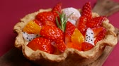 turta : tasty Fresh mixed Fruit Tart on red background