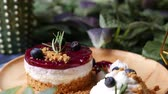 amoras : Delicious homemade cheesecake with berry sauce set on wooden plate.