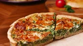 appetizer : Quiche a savoury open tart or flan consisting of pastry crust with spinach mushrooms cheese. Stock Footage