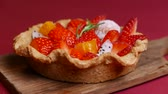orange jelly : tasty Fresh mixed Fruit Tart on red background