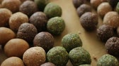 paleo : Healthy snack Organic Dates oatmeal energy balls with green tea, Cocoa, Nuts. Stock Footage