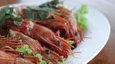 parsleys : Barbecued grilled prawns with basil leaves. Restaurant Seafood dish.