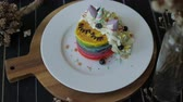 palačinka : Fresh baked cute unicorn Rainbow Pancake with buttercream berry and decorate sugar. kids meal.