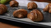 flaky : Fresh croissant a flaky, viennoiserie pastry on wooden board.