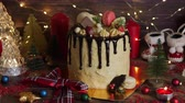 azevinho : Cake for Christmas and winter holidays. Set on wooden dinner table with Christmas decorations.