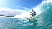 people : Surfer Riding Blue Ocean Wave