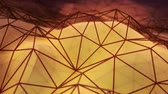 Abstract metal net covering a yellow low poly glossy refractive evolving surface, high tech looping background