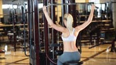 стройный : beautiful young woman is doing exercises at the gym