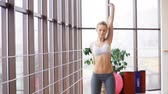 amarelo : Beautiful young girl doing different exercises at the gym Stock Footage