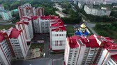 дом : aerial shot of  a few buildings on the edge of town