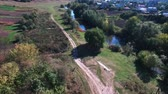 ferrovia : aerial shot of the stone railway bridge outside the city Stock Footage