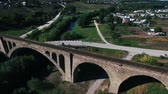 chmury : aerial shot of the stone railway bridge outside the city Wideo