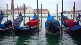 italiano : Gondolas moored by Saint Mark square