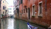 italy : Venetian channel with ancient houses and boats Stock Footage