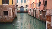 church : Venetian channel with ancient houses and boats Stock Footage