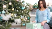 Валентин : smiling woman with many gift boxes Стоковые видеозаписи