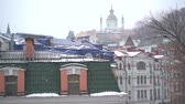 copious snowfall over the city with the roofs of the building and windows Dostupné videozáznamy