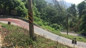 путешествие : Cars and bikes rides on extremely dangerous sharp curve in Thailand