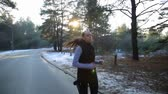 noivo : Young woman with a slender figure is engaged in gymnastics at sunrise. She makes a run along the forest. Camera stabilizer steadycam shot. Stock Footage