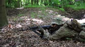 haki : Guerilla partisan warrior aiming in forest ambush carrying his gun. Partisan war reconstruction. Stok Video