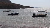 doprava : Small boats bob on choppy waters in Turkish bay in early morning