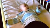 cotão : Baby playing in cot Stock Footage