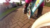 Shot from a GoPro attached to the forks of a little girls bike