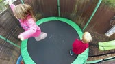 front or back yard : Children play on a trampoline Stock Footage