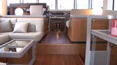 wood : Living room of luxury yacht, with view of the cockpit. Camera movement made with jib crane