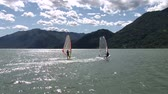 surfe : Windsurfers navigating on a lake in Italy