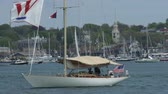 yat : Sailing boat navigates bay in Newport, Rhode Island Stok Video